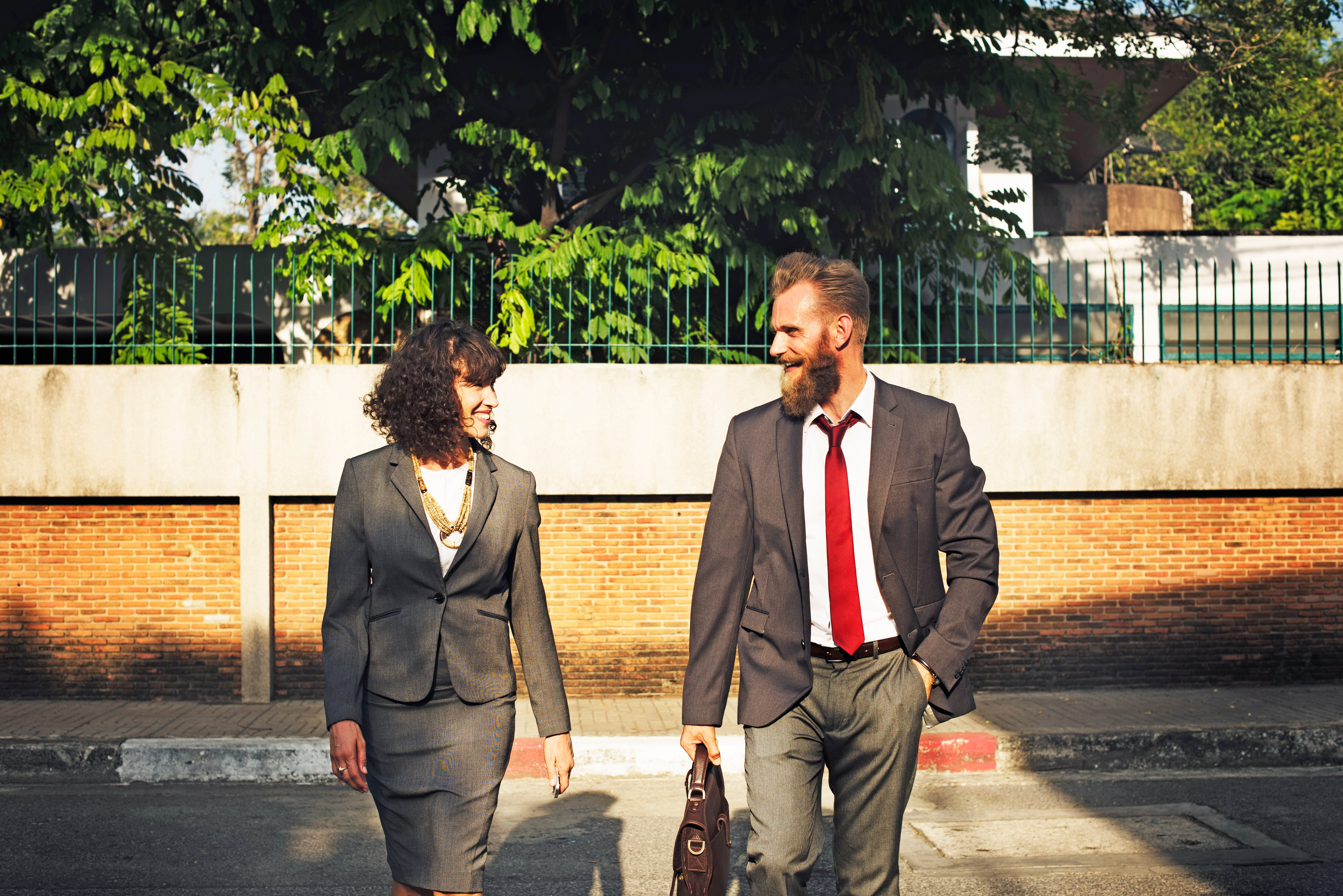 Woman and man in suits talking